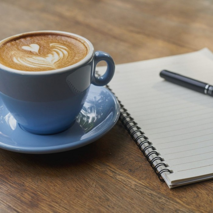 coffee and notebook for marketing tasks without a screen 5 Marketing Tasks You Can Tackle Without Looking at a Screen
