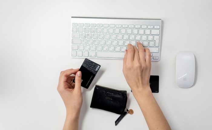 credit card and keyboard how to get repeat customers on your ecommerce site How to Get Repeat Customers Buying from Your eCommerce Website